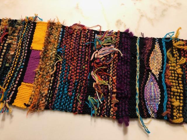 Phyllis S. Assorted weaving styles sampler in Thrumsori scarf.