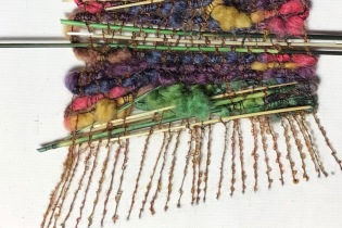 """Linda A. Used boucle for warp and """"seed it on the canvas backing."""