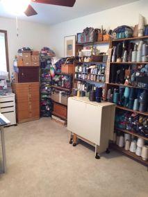 Ellen B. Yarn room shelves of painted warps/tencels
