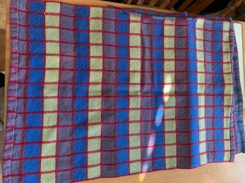 Al N Harley towels. Trying to match colors on a motorcycle. Used Ashford 5/2 cotton. Used a 20 dent reed, block weave. Same silver-gray warp. Changed weft to blue complementaries yellow and red. Back Side. Much brighter colors.