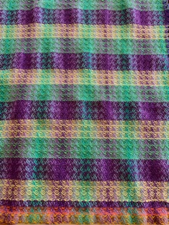 Al N: Purple green was a gradient dyed yarn. Thought it would be more of a violet red analogous. Green was a surprise. Added yellow trying for split complimentary. 7 harness waffle weave from carol strickler. Changed tie-up trying to get rid of floats. Both are 12 EPI sett.