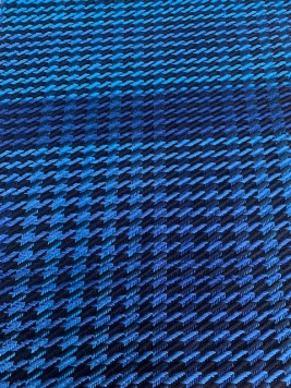 """Al N 12 sett, gradient cotton blue in warp and weft. Added the white weft since I ran out of gradient. The black and bright blue in second are hemp cotton blend, courser. Seems like one """"tooth"""" is thicker than the other. Weft is four threads, warp only 3? Did I goof? Also gradient bobbin changes?"""