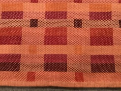 Beth D Guild challenge using red, red/orange, and orange. 2 towels in summer and winter weave. Tie up was changed to weave second towel. 8/2 cotton for warp, tabby weft and pattern weft.