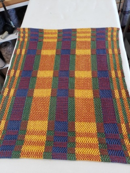 Ginger T 8/4 rug cotton warp. Part of 12 placemats made to match customers dinnerware.