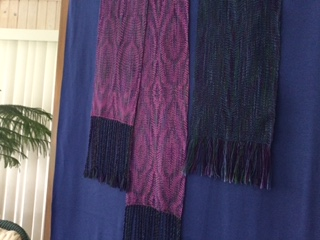 Sandy N. I used Analogous variegated 8/2 Tercel for the warp. The weft for the fuchia was 8/2 bamboo. I had some warp left over so I tried a blue rayon for the weft. The scarf pattern was from Sixty Scarves for 60 Years. It is called Diamond back twill. It is set at 30 epi. I reversed the treadling for the scarf which was an accidental moment and liked it better. The small sample was woven as written. Not much shrinkage at all.