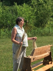 Wonderf demo of preparing flax for spinning into Linen